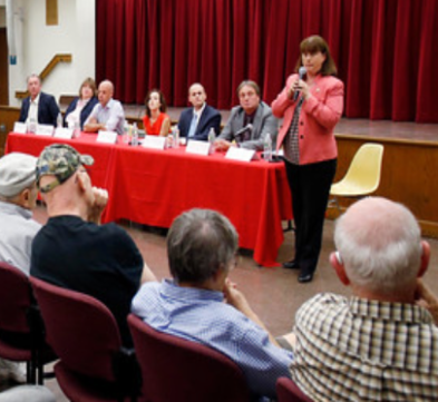 Incumbent State Representative candidate Tricia Farley-Bouvier introduces herself.